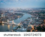 london at night with urban... | Shutterstock . vector #1043724073
