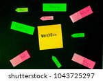 Small photo of Close-up of colorful notes On a bl ack background. Business Planning Concept, Competition, Digital Economy And digital currency