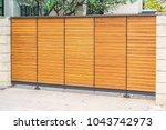 sliding wooden gate on wheels. | Shutterstock . vector #1043742973