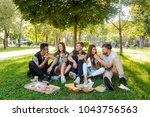 company of beautiful young... | Shutterstock . vector #1043756563