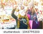 young girl and her mother are...   Shutterstock . vector #1043795203