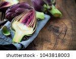fresh purple artichokes on dark ...   Shutterstock . vector #1043818003