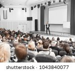 speaker conducts the business... | Shutterstock . vector #1043840077