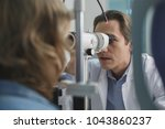 concentrated doctor examining...   Shutterstock . vector #1043860237