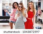pretty girls wearing sunglasses ... | Shutterstock . vector #1043872597