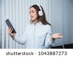 pretty smiling businesswoman in ... | Shutterstock . vector #1043887273