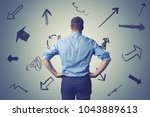 confused businessman with... | Shutterstock . vector #1043889613