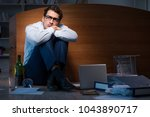 stressed businessman working... | Shutterstock . vector #1043890717