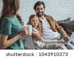 father hugging daughter and... | Shutterstock . vector #1043910373