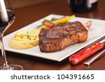 A delicious Bone In Rib-Eye Steak, narrow focus on meat - stock photo