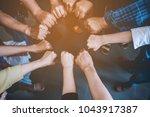 teamwork unity arms...   Shutterstock . vector #1043917387