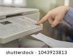 copier start  finger pressing... | Shutterstock . vector #1043923813