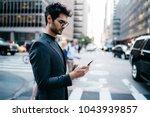 pensive businessman in suit... | Shutterstock . vector #1043939857
