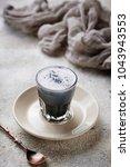 black charcoal latte.  detox...   Shutterstock . vector #1043943553