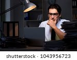 young businessman working... | Shutterstock . vector #1043956723