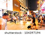 HONG KONG - MAY 19: Crowded street on May 19,2012 in Hong Kong. With a land mass of 1,104 km and population of 7 million people, Hong Kong is one of the most densely populated areas in the world - stock photo