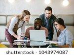 business team in office look in ... | Shutterstock . vector #1043974087