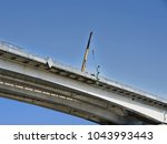 construction of a bridge over... | Shutterstock . vector #1043993443