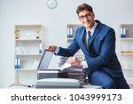 businessman making copies in...   Shutterstock . vector #1043999173