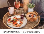 waffles served with fresh... | Shutterstock . vector #1044012097