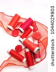 red sewing thread on a white... | Shutterstock . vector #1044029803