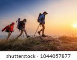 lady hikers walking in the... | Shutterstock . vector #1044057877