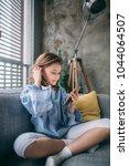 little girl sitting on the... | Shutterstock . vector #1044064507