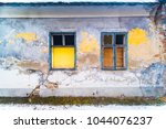 grunge cracked brick wall house ... | Shutterstock . vector #1044076237