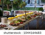 buffet served table with snacks ... | Shutterstock . vector #1044164683