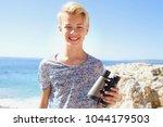 portrait of beautiful tourist... | Shutterstock . vector #1044179503