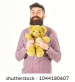 guy with beard hugs soft toy... | Shutterstock . vector #1044180607