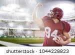 american football player... | Shutterstock . vector #1044228823