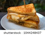 grilled cheese sandwich | Shutterstock . vector #1044248437