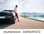 man solo traveler on cabriolet... | Shutterstock . vector #1044249373