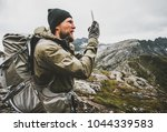man traveler using smartphone... | Shutterstock . vector #1044339583