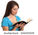young woman reading from the Bible - stock photo