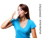 beautiful woman drinking a cold glass of milk - stock photo