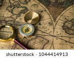retro compass with old map and... | Shutterstock . vector #1044414913