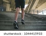 close up shot of runner's legs... | Shutterstock . vector #1044415933