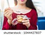 girl enjoying tiramisu dessert...   Shutterstock . vector #1044427837