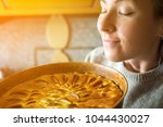 young woman holding a baking... | Shutterstock . vector #1044430027