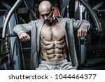 brutal sexy strong bodybuilder... | Shutterstock . vector #1044464377