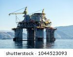 Small photo of Rio de Janeiro, Brazil, August 4, 2013: Petrobras Petroleum Platform P61 TLWP (Tension Leg Wellhead Platform) being transferred to the Campos production Field from the Angra bay.