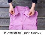 woman hands and pink shirt... | Shutterstock . vector #1044530473