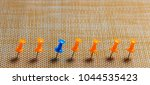 stationary  blue pushpin in row ... | Shutterstock . vector #1044535423