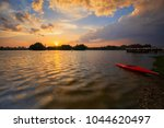 sunset which a single boat | Shutterstock . vector #1044620497