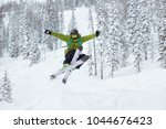 skier jumps at offpiste ski... | Shutterstock . vector #1044676423