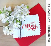 Small photo of Hello May hand lettering card. Spring flowers in envelope.
