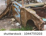 old rusty car. bumper of an old ... | Shutterstock . vector #1044755203