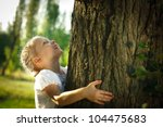 Little Girl Hugging A Tree ...